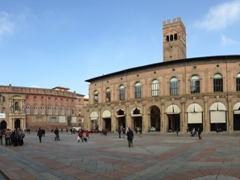 Piazza Maggiore, Bologna's central square surrounded by the Basilica of San Petronio, the City Hall Building, the portico dei Banchi and the Palazzo del Podestà