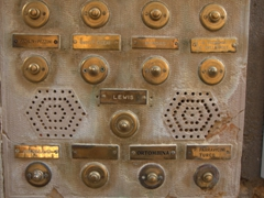 Old fashioned brass doorbells and name plates