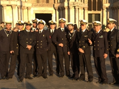 Italian navy crew members pose in front of St Mark's Basilica