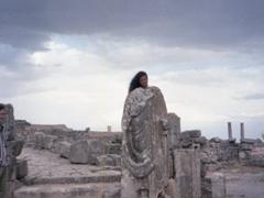 Becky behind a headless Roman Statue; Dougga