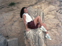 Naughty Becky hops on the lap of a Roman statue; Dougga