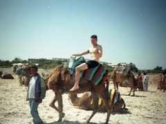 Sean enjoying his camel ride; Hammamet