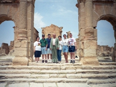 Pad offers to take a photo of us standing in front of the Capitoline temples of Sbeitla