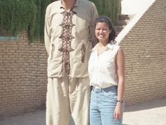 Becky standing next to the tallest man on earth!
