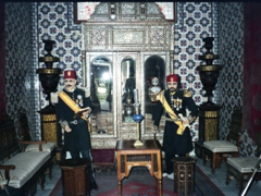 Uniformed wax statues on display in an ornate room; Dar Cherait