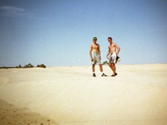Ryan and Pad showing off their abs somewhere in a Tunisian desert