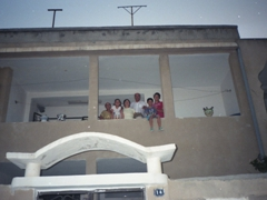 Becky's Tunisian host family posing on their balcony: Noora, Anayah, Dr Foouzia, Mohammed, Achmad and Ameera