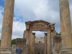 Robby sitting in the 2nd century richly carved gateway of the Roman temple of Dionysus; Jerash