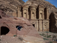 """Robby peeks out from a cave opening in front of """"The Monastery"""", Petra"""