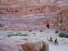 Tourists riding camels in front of Petra's theater