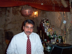 Our bartender kept us supplied with drinks all night long; Cave Bar in Petra