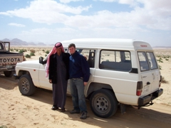 Our friendly driver strikes a pose with Robby; Wadi Rum
