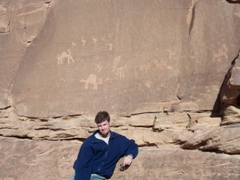 Robby in front of some ancient stone etchings (notice the camels and ostrich markings); Wadi Rum
