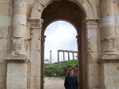 Becky at the Arch of Hadrian, an 11m high triple arched gateway; Jerash