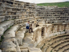 Robbing sitting in the North Theater; Jerash