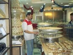 Robby buying delicious baklava in a bakery; Amman