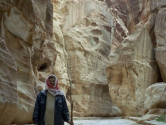 Cleaner tasked with sweeping up horse poop; Petra Siq