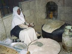 Jordanian lady making flatbread at our restaurant in Amman