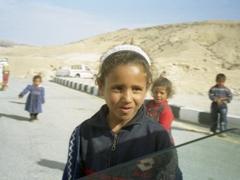 Friendly children rush to greet us; near Little Petra