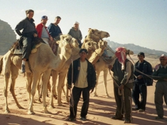 Ready to dismount after our very long (and uncomfortable) camel ride; Wadi Rum