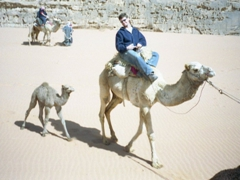 Robby's camel had a baby that followed them on the entire trek through Wadi Rum