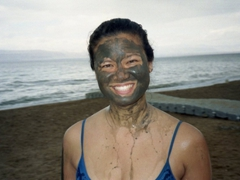 Becky dabs a little bit of mud on her face; Dead Sea