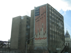 "The rather large ""Down With The U.S.A"" mural on the side of this Tehran building caught our attention (notice the skulls in lieu of stars and the rockets screaming downward)"