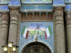 Ever seen a machine gun mural displayed over the entrance to a religious building? Tehran propaganda is everywhere