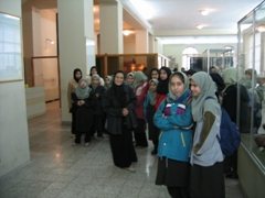 Curious school girls bashfully make eye contact with us at the National Museum, Tehran