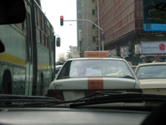 Orange and white colors of the Tehran Taxi cab