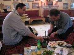 Amin prepares our lunch at a cosy restaurant in Tehran