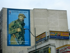 We saw several billboards (such as this one) plastered on the sides of buildings glorifying war, Tehran