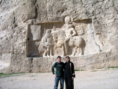 "Posing in front of the most famous of the Sassanid Reliefs, ""The Triumph of Shapur"" depicts the Sassanid Monarch Shapur defeating two Roman Emperors, Valerian and Philip the Arab; Naqsh-e Rustam"