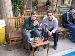 Robby & Amin puffing on a water pipe, Hafez Tomb, Shiraz