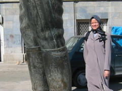 Becky stands next to a pair of bronze boots, the remains of a gigantic statue of Reza Shah at Sa'd Abad Complex, Tehran