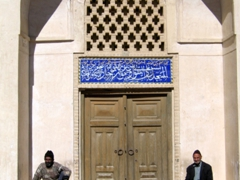 Men sitting outside Jame Mosque, Naein