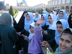 Excited Iranian schoolgirls think they've spotted a celebrity (Robby); Imam Square, Isfahan
