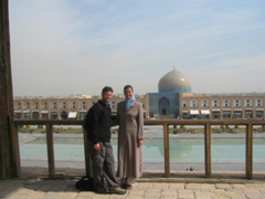 On the balcony of Ali Qapu Palace with the beautiful backdrop of the Lotfollah Mosque; Isfahan