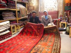 Buying Iranian carpets, Imam Square, Isfahan
