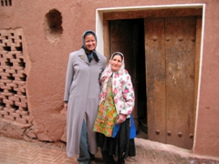 Becky and a traditionally dressed (a predominantly white long scarf that covers the shoulders with a colorful pattern and an under knee skirt) Abyaneh woman