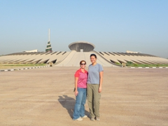 "Brandy & Becky in front of the more commonly monikered ""Tomb of the Unknown Soldier"" (there actually is no tomb or body, so it really should be called the Monument of the Unknown Soldier); International (Green) Zone in Baghdad"