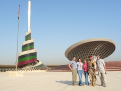 Becky, Kelly, Brandy, an Iraqi soldier, and Robby strike a pose at the Monument to the Unknown Soldier; Baghdad