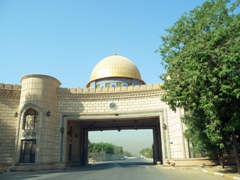 Driving under the Golden Dome Gate in Baghdad's International Zone