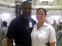 "Dennis Haysbert (aka SGM Jonas Blane on ""The Unit"" or President Palmer on ""24"") poses with Becky during a USO tour; Camp Victory"