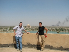 "Posing on the rooftop of the Victory Over America/Iran Palace (Saddam's brothel aka ""Perfume Palace"" is in the background)"