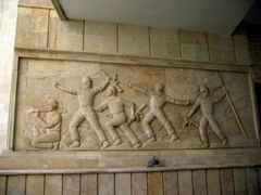 Bas relief of soldiers in battle on a building at Camp Victory