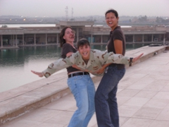 Kelly & Becky clowning around with Melissa, rooftop of Al Faw Palace