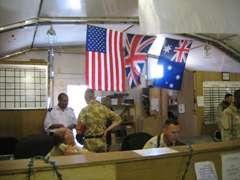 US, British and Australian flags signify the coalition forces working at this military flight terminal