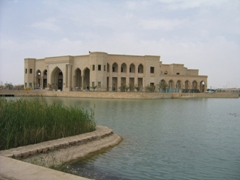 Artificial lake side view of Al Faw Palace, commissioned by Saddam Hussein to signify the Iraqi ownership of Al Faw Peninsula after the Iraq/Iran war