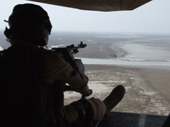 The gunner's view; helicopter ride to another base camp in Iraq